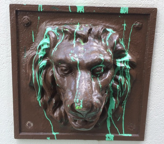 What's My Lion? - doing with green paint on him?