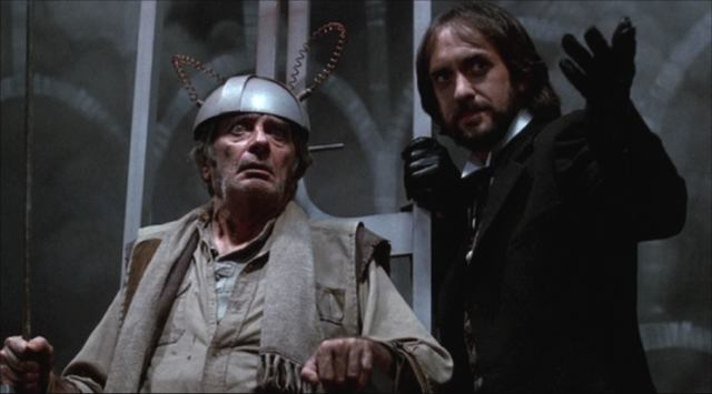 Royal Dano as Tom Fury and Jonathan Pryce as Mr Dark
