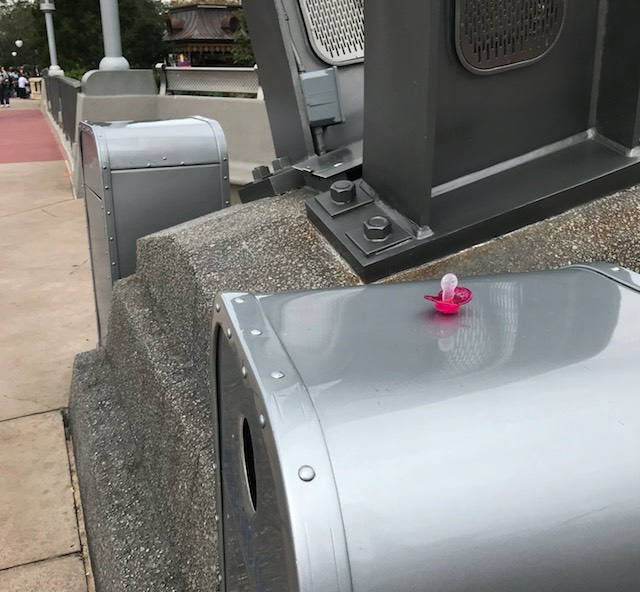 pacifier on a trash can