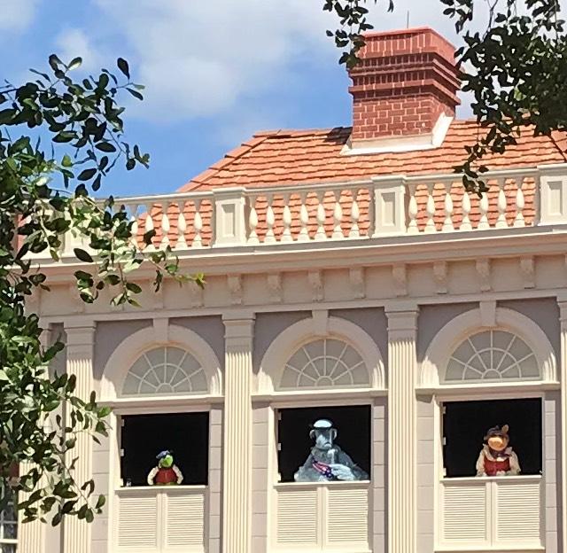 Three muppets at windows