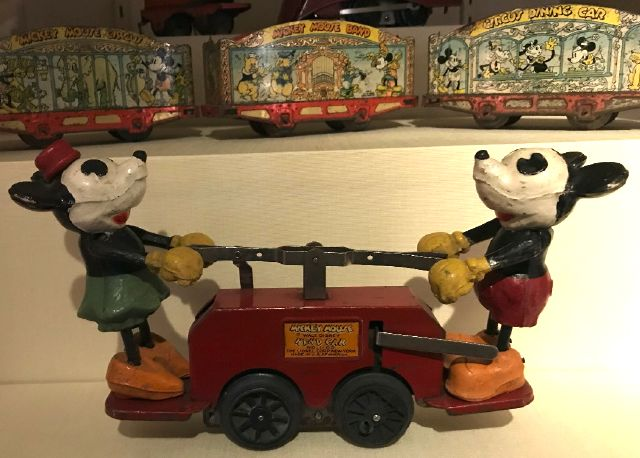Minnie & Mickey on a handcar